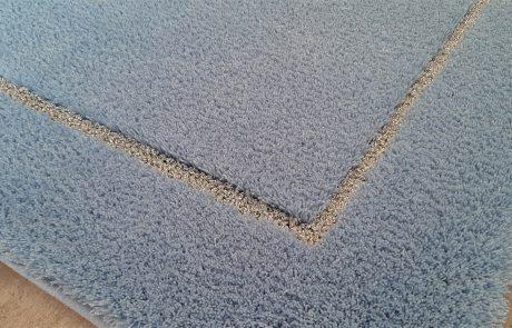 Badteppich nach Maß - Florhöhe 25mm Velours in Kombination mit Silber Lurex in 9mm als Schlingenkontur - Detail